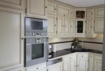 Cuisine ROCCHETTI Blois ivoire plan travail granit